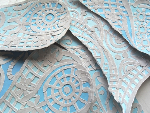 Blue ripped paper swirls